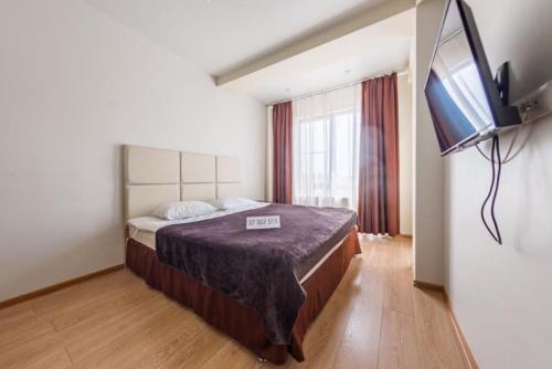 Кровать или кровати в номере Апартаменты в Олимпийском Парке