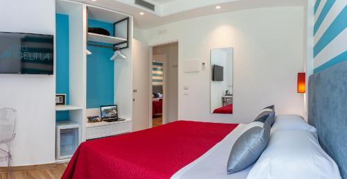 Letto o letti in una camera di Hotel Angelina