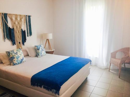 Ein Bett oder Betten in einem Zimmer der Unterkunft Marina Club Lagos Resort