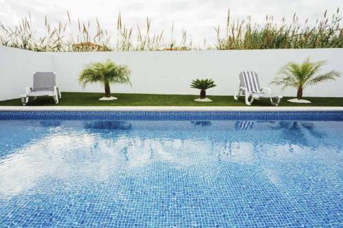 The swimming pool at or near Deluxe Villa - Holiday House - By SCH