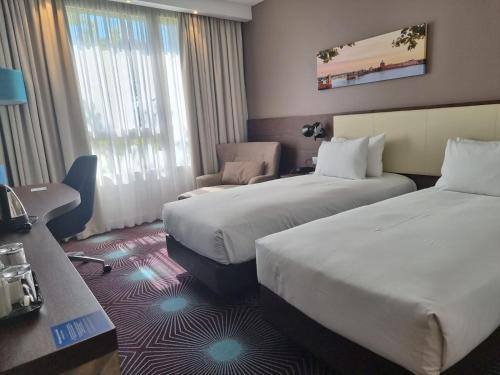 A bed or beds in a room at Hampton By Hilton Toulouse Airport