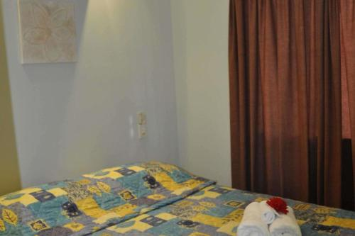 A bed or beds in a room at Ingenia Holidays Townsville