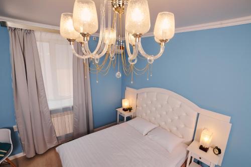 Кровать или кровати в номере ZBest hotels Айсберг Саратов