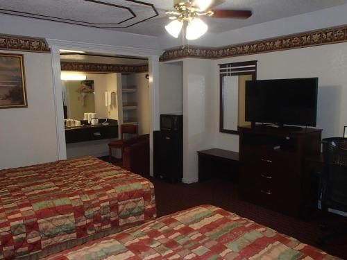 A television and/or entertainment center at Budget Inn and Suites Corpus Christi