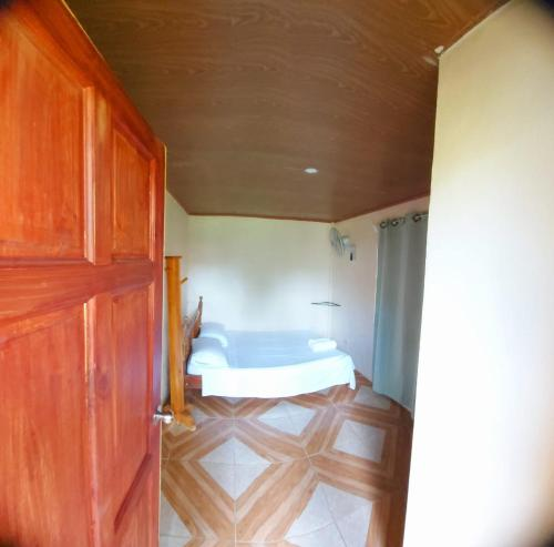 A bed or beds in a room at Yubarta Lodge