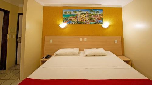 Cama ou camas em um quarto em Hotel Costeiro
