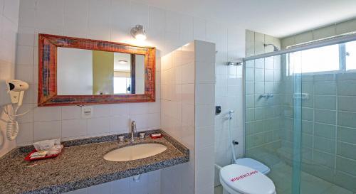 Um banheiro em Hotel Costeiro
