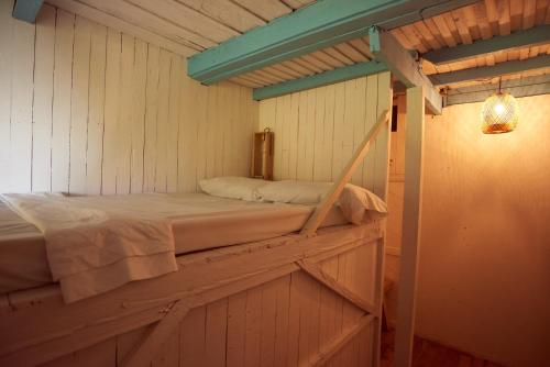 A bed or beds in a room at Hostel Casa Azul