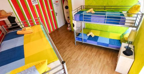A bunk bed or bunk beds in a room at Ericeira Surf Camp