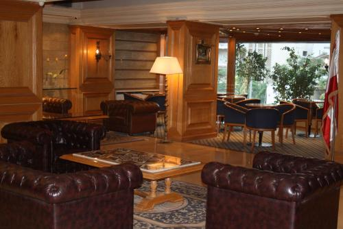 The lounge or bar area at Grand Hotel Beirut