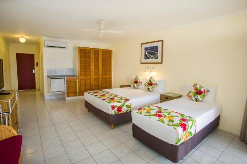 A bed or beds in a room at The Edgewater Resort & Spa