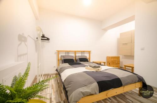 A bed or beds in a room at homestay