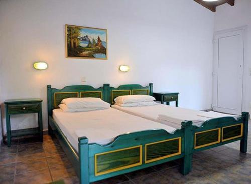 Letto o letti in una camera di Amalia Apartments