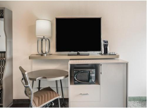A television and/or entertainment center at Holiday Inn Roanoke - Valley View, an IHG Hotel