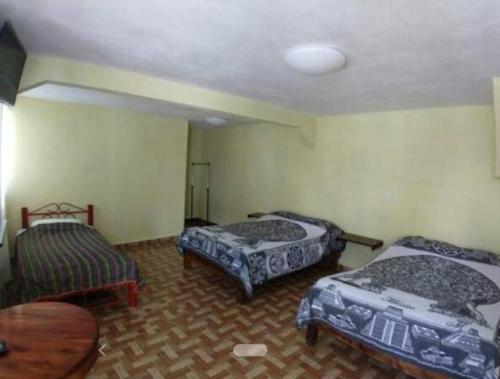 Cama o camas de una habitación en Hotel Primavera