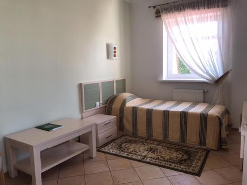 Кровать или кровати в номере Becker Hotel