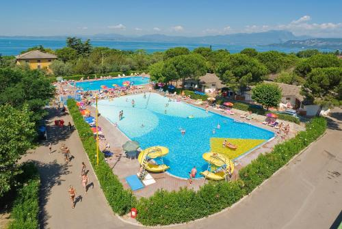 A view of the pool at Happy Camp Mobile Homes in Camping Cisano San Vito or nearby