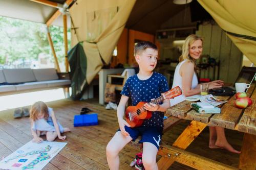 A family staying at Glamping Camp Soline