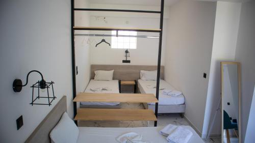 Ein Bett oder Betten in einem Zimmer der Unterkunft Kalypso studio Resorts