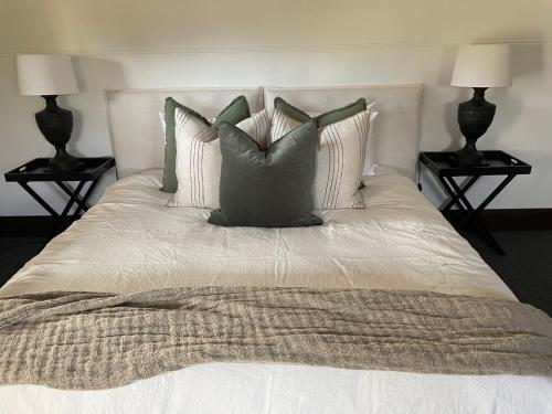 A bed or beds in a room at Ballina Manor Small Luxury Hotel