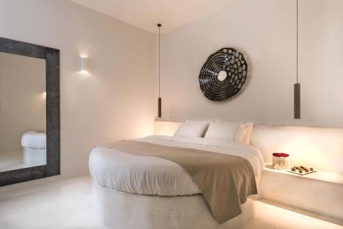 A bed or beds in a room at Andronis Concept Wellness Resort