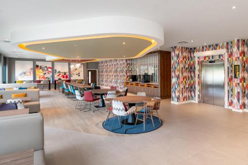 A restaurant or other place to eat at Hampton by Hilton High Wycombe