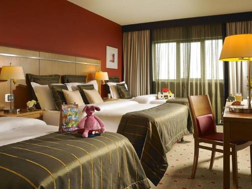 A bed or beds in a room at Clayton Hotel Liffey Valley