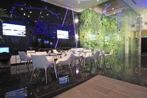 A restaurant or other place to eat at Arton Boutique Hotel (SG Clean)