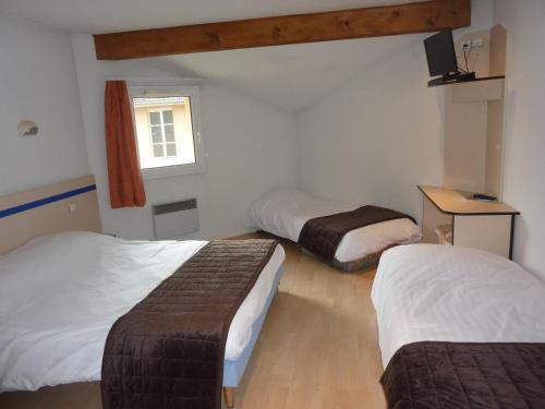 Un ou plusieurs lits dans un hébergement de l'établissement Lac'Hotel France