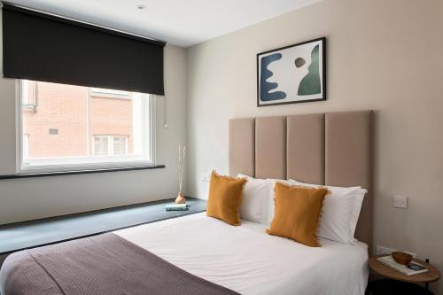 A bed or beds in a room at COVE Cannon Street