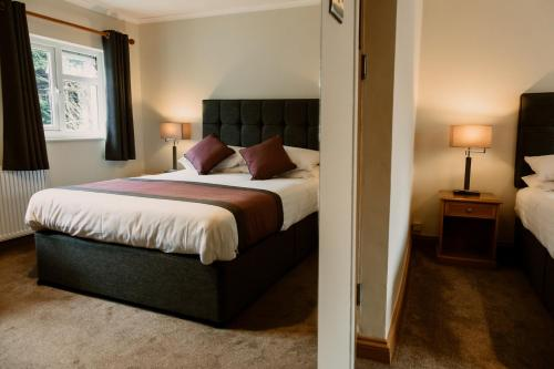 A bed or beds in a room at St. Davids Cross Hotel