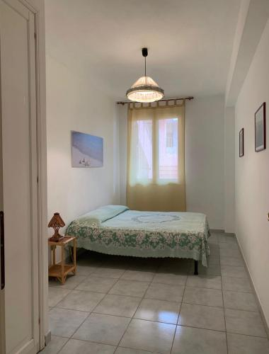 A bed or beds in a room at Lopadusa trilo 1