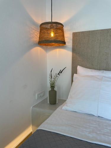 Vuode tai vuoteita majoituspaikassa Blu Rooms