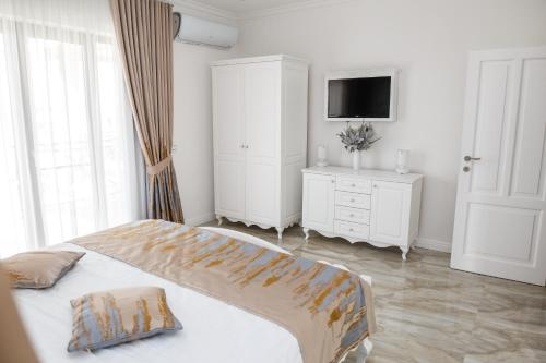 A bed or beds in a room at Carpe Diem Spa