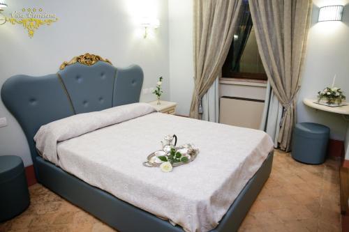 Letto o letti in una camera di Villa Floridiana