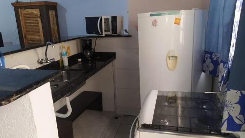 A kitchen or kitchenette at Encantu's Flats