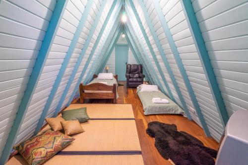 A bed or beds in a room at Pousada Alto Da Boa Vista