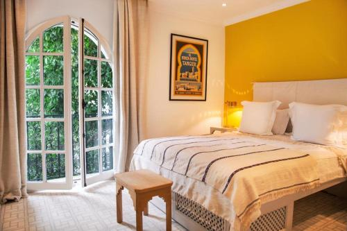 A bed or beds in a room at Riad Mokhtar