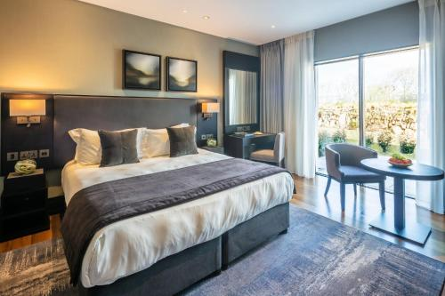 A bed or beds in a room at Twr y Felin Hotel