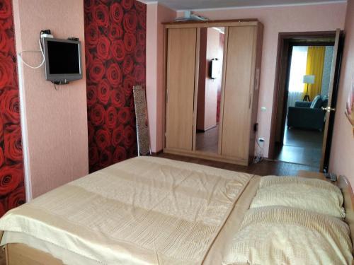 Кровать или кровати в номере 2-комнатные апартаменты на 9 Января
