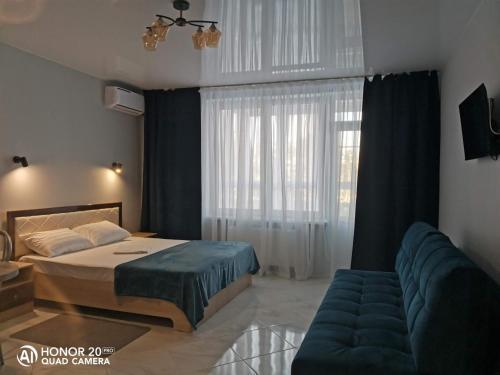 Кровать или кровати в номере Апартаменты жк Кавказ