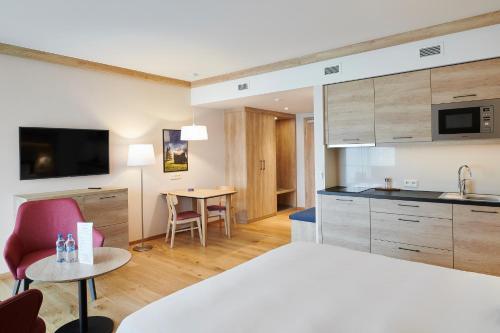 A kitchen or kitchenette at Radisson Blu Hotel & Residences