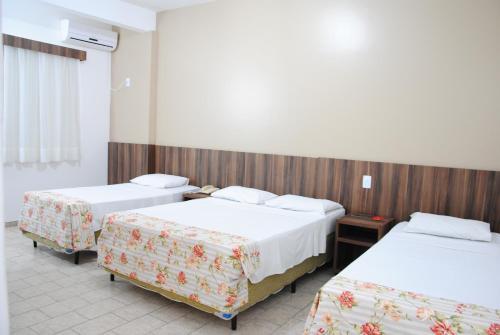 Cama ou camas em um quarto em Hotel Morada do Sol
