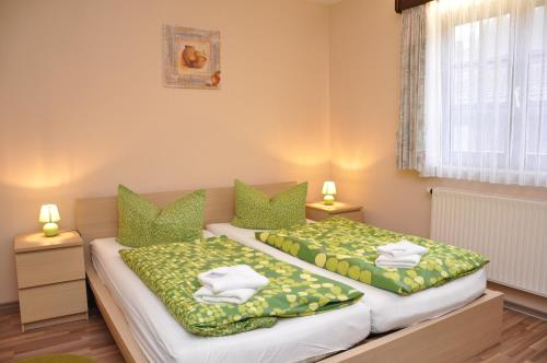 Ein Bett oder Betten in einem Zimmer der Unterkunft Hotel Jägerklause
