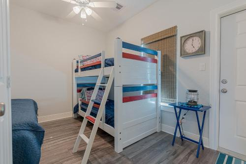 A bunk bed or bunk beds in a room at The Coast is Clear Amazing home in Sea Isle Short distance to the Beach