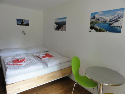 A bed or beds in a room at Valley Hostel