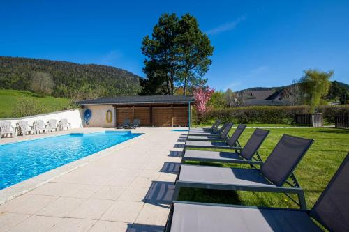 The swimming pool at or near Logis Le Vernay