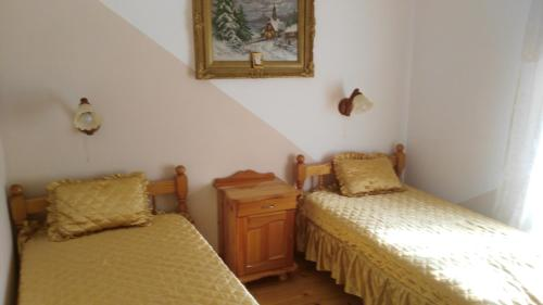 A bed or beds in a room at Guest House PETROVA