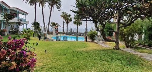 Het zwembad bij of vlak bij Apartamentos Casas Carmen