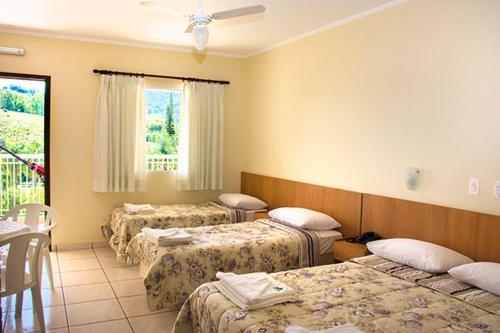 Cama ou camas em um quarto em Hotel Fazenda M1